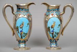 A pair of 19th/20th century Chinese Export silver enamel decorated ewers Each with crane vignettes