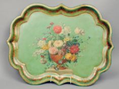 A 19th century papier mache tray Of serpentine form, decorated with a vase of flowers within a
