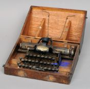 A Blickensderfer No. 5 typewriter Of typical form, housed in a wooden travelling case.  32.5 cms