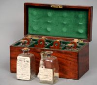 A 19th century mahogany tincture box The rectangular hinged top with recessed carrying handle