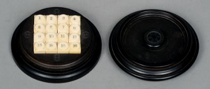A 19th century game Comprising carved bone counters numbers 1 to 16, housed in a turned hardwood box