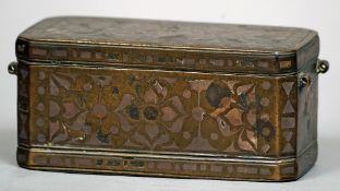 An 18th century Islamic bronze betel box Of typical form, the hinged lid enclosing three
