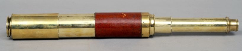 A 19th century brass and mahogany three draw telescope, the barrel inscribed Dolland, London, Day or