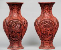 A pair of 18th/19th century Chinese red cinnabar lacquer baluster vases Each of quatrefoil section