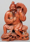 An early 20th century Chinese carved soapstone figure Formed as a bearded gentleman holding a