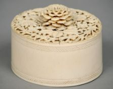 A 19th century carved ivory tusk section box The removable lid intricately carved with floral