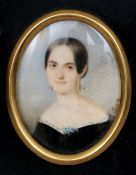 A 19th century portrait miniature on ivory Depicting a young girl with coral earrings,