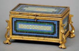 A late 19th century Continental mosaic mounted ormolu jewellery casket The hinged rectangular lid
