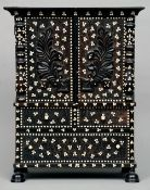 A 19th century Ceylonese bone inlaid ebony miniature secretaire chest The moulded cornice above a