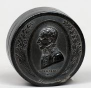 A French 19th century pressed tortoiseshell snuff box The cover worked with a profile portrait of