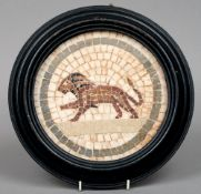 A circular framed mosaic panel Made of various specimen stones and centred with a lion, mounted in