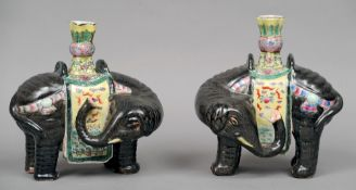 A pair of Chinese elephant form candlesticks Each naturalistically modelled standing on all
