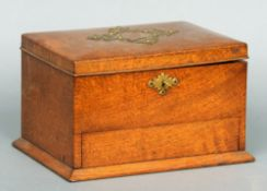 A Victorian oak humidor The brass mounted hinged rectangular lid enclosing the twin division