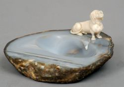 A small carved ivory model of a Dachshund Naturalistically modelled and applied to an agate