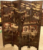 A 19th century Chinese four fold lacquered screen Decorated with figures and pagodas before a