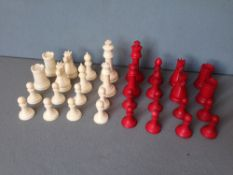 A Victorian carved and stained ivory Staunton pattern chess set The kings 7.5 cms high.