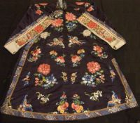 A 19th century Chinese embroidered silk robe Decorated throughout with butterflies, fish and
