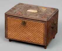A Continental carved wood table cabinet The geometrically moulded mother-of-pearl inset