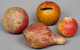 Four pieces of 19th century painted pottery imitation fruit Comprising: three apples and a pear.