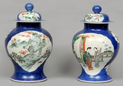A pair of 19th century Chinese porcelain baluster jars and covers Each painted with figures and bird