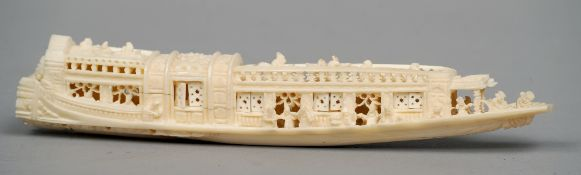 An ivory group Carved as figures aboard a traditional boat.  23 cms long.   CONDITION REPORTS: