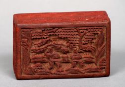 A small circular cinnabar lacquered box and cover Of circular form decorated with various