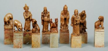 A set of ten Chinese carved soapstone seals Each variously carved with a figure or an animal.