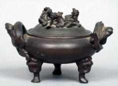 A Chinese patinated bronze censor The dragon mounted domed removable lid above the main bulbous body