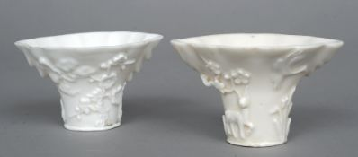 Two 19th century Chinese blanc de chine libation cups Each of typical form with various floral and