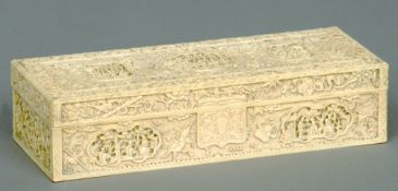 A 19th century Cantonese carved ivory box The removable rectangular lid carved with panels of