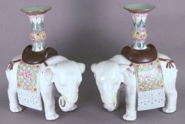 A pair of Chinese porcelain candlesticks Modelled as elephants.  20 cms high.  (2)   CONDITION