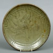 A Chinese Provincial pottery dish, possibly Ming With incised floral decoration and geometric