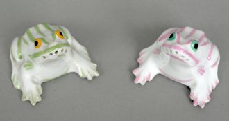 A pair of Theodore Haviland porcelain cruets Each formed as a frog, one decorated in green, the