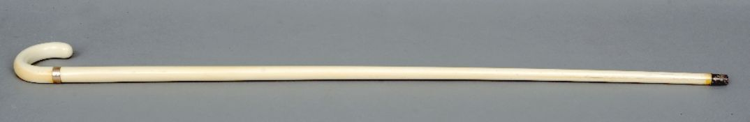 A 19th century ivory gentleman's walking stick The single piece shaft mounted with a gold ring and a