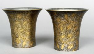A pair of 19th century silvered bronze cups, possibly Persian Each with engraved scrolling floral