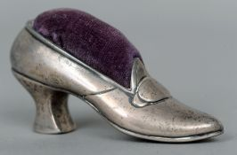 A Sterling silver pin cushion formed as a shoe 8.5 cms wide.   CONDITION REPORTS:  Cushion worn,