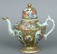 A 19th century Cantonese famille rose teapot The domed lid above the tapering body decorated with