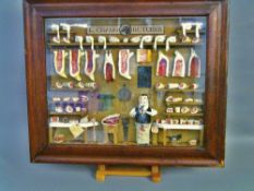 A diorama of a butcher's shop Framed and glazed.  45 cms wide.   CONDITION REPORTS:  Generally in