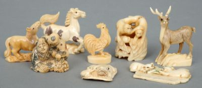 A carved ivory netsuke Formed as two figures; together with seven other animal form carved netsukes.