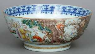 An 18th century Cantonese punch bowl Decorated in the round with various figures in interiors and