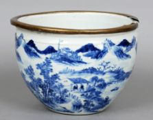 A 19th century Chinese blue and white jardiniere The brass mounted rim above the main bulbous body