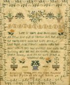 A 19th century needlework sampler Worked with a verse within floral sprays and strawberry border,