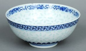 A 19th century Chinese blue and white rice bowl Centrally decorated with a five claw dragon