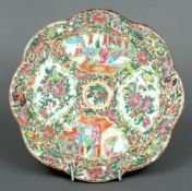 A 19th century Cantonese famille rose porcelain plaque Of lobe circular form, typically decorated