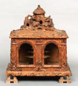 A 19th century Blackforest carved liqueur box The hinged domed lid with dogs before a cottage, the