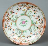 An Chinese porcelain charger Decorated with blossoming trees within a garden landscape.  31.5 cms