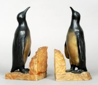 A pair of Art Deco spelter and alabaster bookends Each naturalistically modelled as a penguin.  25.5