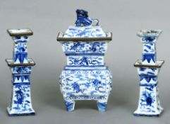 A 19th century Chinese blue and white censor and a pair of blue and white candlesticks The removable