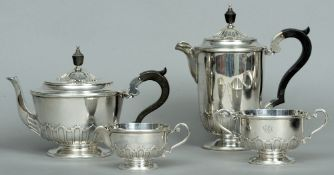 A George V silver four piece tea and coffee set, hallmarked London 1917, maker's mark of