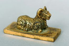 An Eastern gilt bronze seal, possibly 18th century Surmounted with the figure of a ram.  6 cms long.